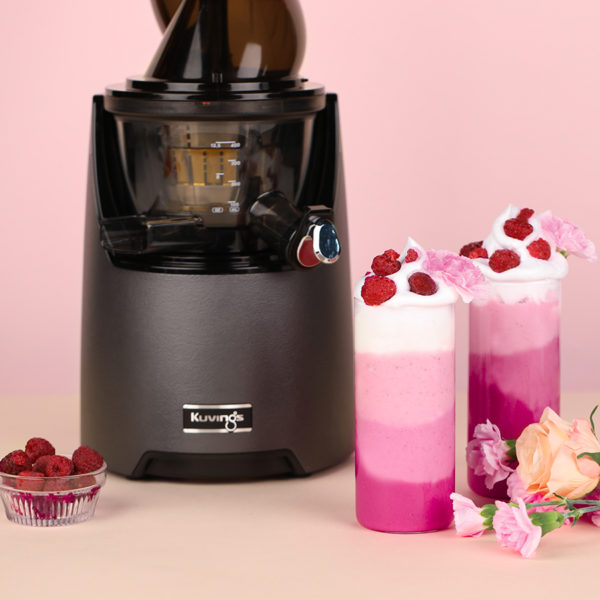 Raspberry Smoothie in glass next to Kuvings EVO820